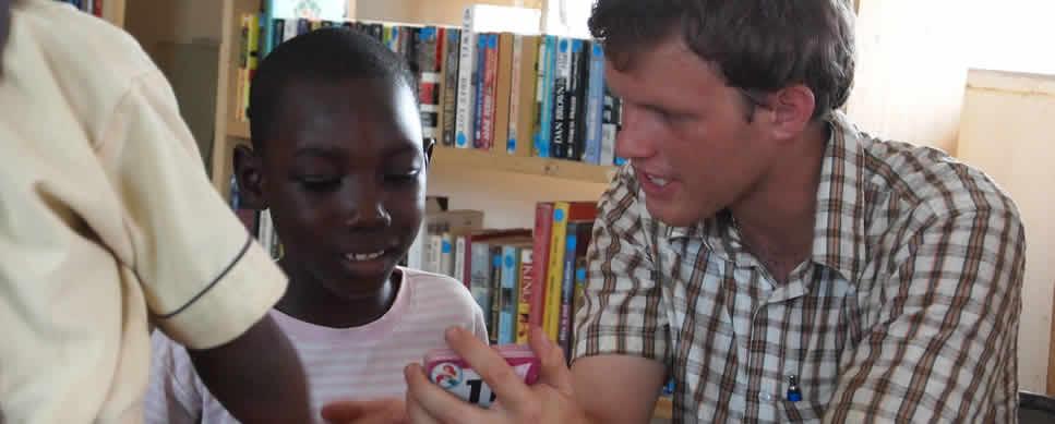 Volunteer tutoring in reading in Ghana's Volta Region