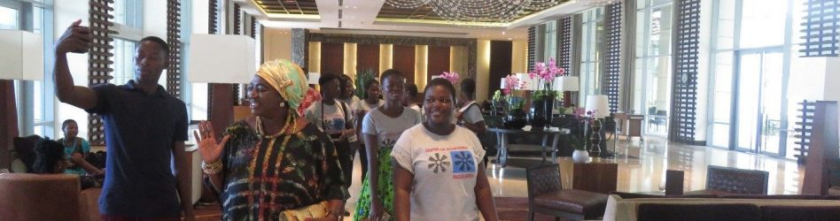 Queen Mother, Mama Atrato arrives at the conference with our students.